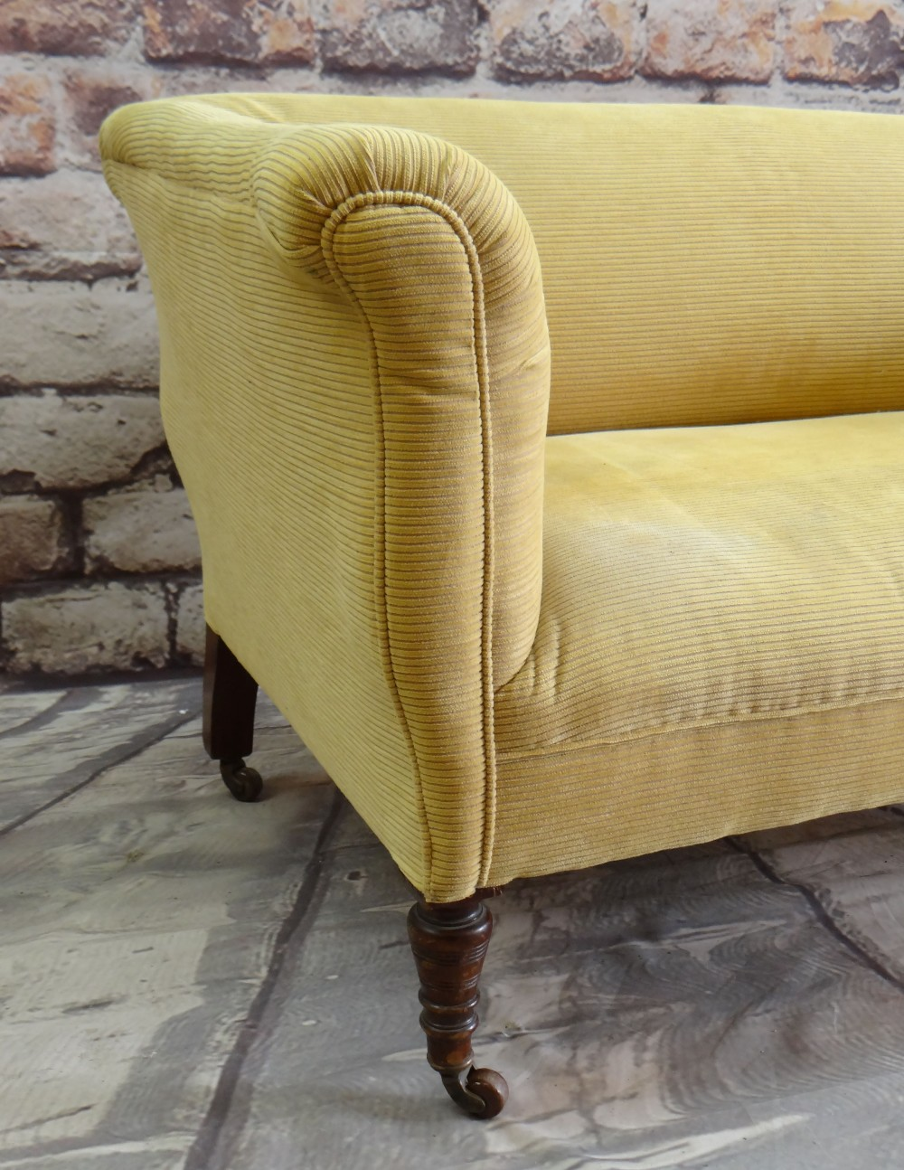 VICTORIAN WALNUT TWO-SEATER SOFA, later yellow ribbed upholstery, turned legs, castors 142 x 70cms - Image 3 of 3