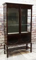 EARLY 20TH CENTURY MAHOGANY CHINA CABINET, shaped doors and glazed sides, cupboards under and