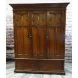 CAROLEAN-STYLE OAK TRIPLE WARDROBE, c. 1920, cavetto dentil cornice above panelled doors and 2