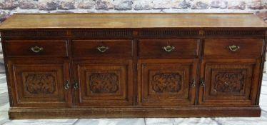 ANTIQUE CARVED OAK DRESSER BASE, top with low back rail above reeded frieze and four drawers, carved