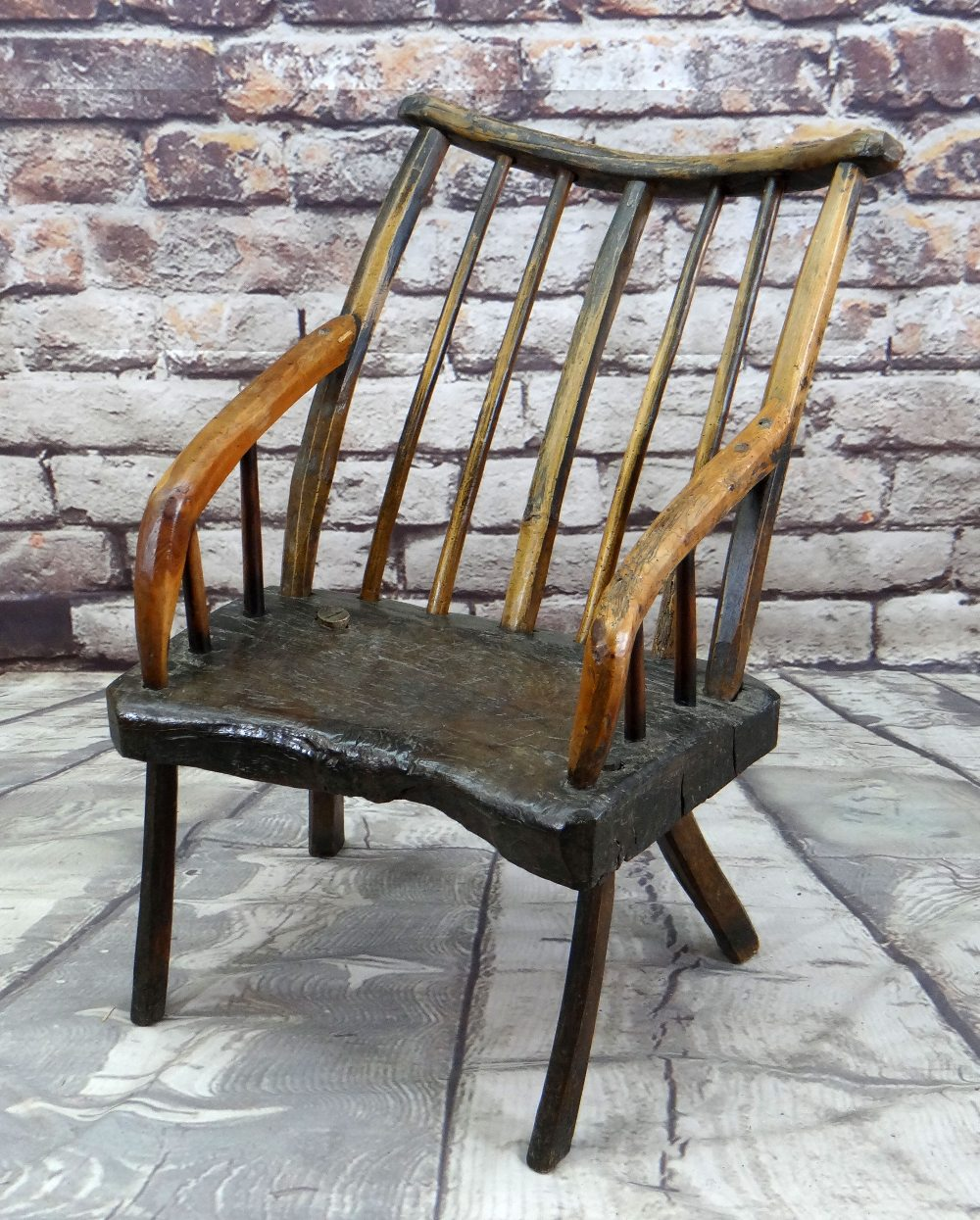 PRIMITIVE OAK & ASH ARMCHAIR, raked comb back with spindles and down-turned arms, thick