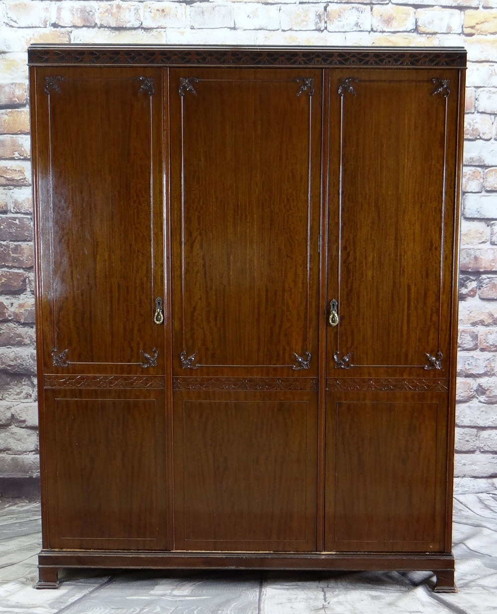 GEORGIAN CHIPPENDALE-STYLE TRIPLE MAHOGANY WARDROBE, blind fret carved frieze above panelled doors