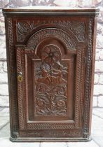 CARVED OAK & INLAID HANGING CORNER CUPBOARD, with breakarch door decorated with putto holding a