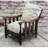EDWARDIAN ARTS & CRAFTS-STYLE OAK LIBRARY CHAIR, slatted sides and incremental reclining back,