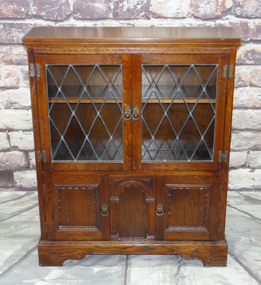 REPRODUCTION OAK BOOKCASE, probably 'Old Charm', with leaded glass cupboard top and panelled base on