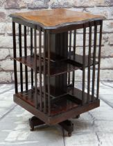 EDWARDIAN MAHOGANY & MARQUETRY REVOLVING BOOKCASE with shaped inlaid top, 50cms wide