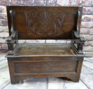 REPRODUCTION OAK MONK'S BENCH, lions carved arms and carved shiled top, 107cms wide