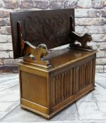 REPRODUCTION OAK MONK'S BENCH with lion arm supports, shield carved top and linen fold front, 106cms