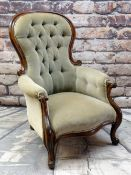VICTORIAN WALNUT BALLOON BACK ARMCHAIR, button upholstered in olive green velour, scrolled back