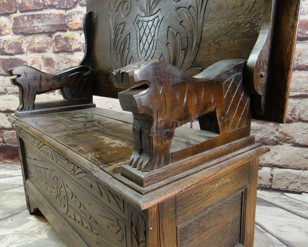 REPRODUCTION OAK MONK'S BENCH, lions carved arms and carved shiled top, 107cms wide - Image 3 of 5