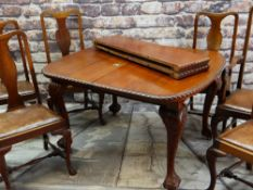 VICTORIAN STYLE EXTENDING DINING TABLE and SEVEN CHAIRS, with gadroon moulded top and leaf capped