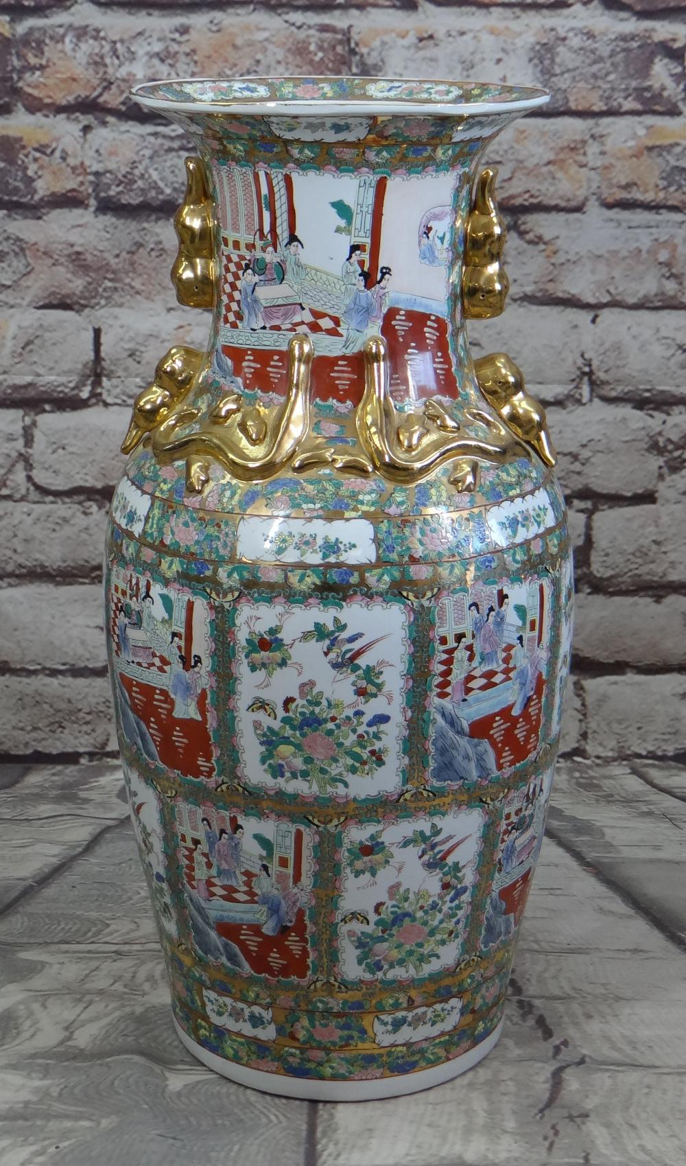 LARGE MODERN CHINESE CANTON FAMILLE ROSE FLOOR VASE, gilt handles, panels decorated with Manchu