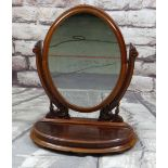 LATE VICTORIAN WALNUT OVAL DRESSING TABLE MIRROR with carved foliate supports and oval box base,