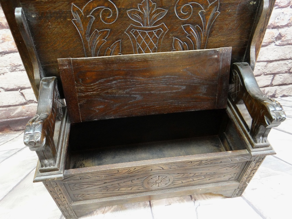 REPRODUCTION OAK MONK'S BENCH, lions carved arms and carved shiled top, 107cms wide - Image 4 of 5