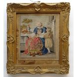VICTORIAN WOOLWORK PICTURE, embroidered with an elderly bearded gentleman and chid beside a table