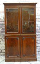 GEORGE III-STYLE MAHOGANY BOOKCASE with dentil cornice, astragal glazed doors, adjustable shelves on