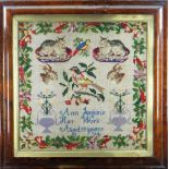 19TH CENTURY SAMPLER depicting birds, seated cats on cushions, hare heads, floral vases, all