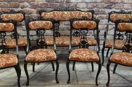 EARLY 20TH CENTURY EBONISED SALON SUITE, carved cresting rails and splats, comprising settee, two