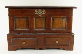 ANTIQUE OAK COFFER BACH, moulded hinged top above triple panelled front, a pierced brass