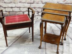 A NEST OF THREE WALNUT OCCASIONAL TABLES with carved edges, legs, claw & ball feet, and a