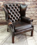 A MODERN REPRODUCTION GEORGIAN-STYLE WING-BACK LEATHER ARMCHAIR, brown button upholstered and