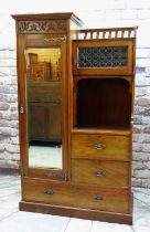 ARTS & CRAFTS-STYLE MAHOGANY WARDROBE / COMPACTUM, with mirrored door, floral carved frieze, gilt