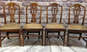 SET OF FOUR EARLY 19TH CENTURY OAK SIDE CHAIRS with pierced vase splats, tapering solid seats and