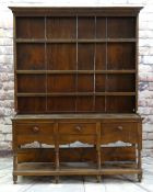 MODERN REPRODUCTION OAK WELSH DRESSER, boarded delft rack with wrought iron hooks, on base fitted