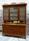 EDWARDIAN OAK KITCHEN DRESSER, foliate carved pediment above shaped cornice and paper-lined and