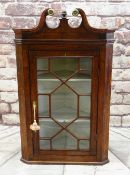 18TH CENTURY OAK HANGING CORNER CABINET, swan neck pediment with brass caps, later acorn finial,