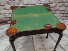 A GEORGE III-STYLE MAHOGANY FOLD-OVAL CARD TABLE, inlaid baize playing surface with dished