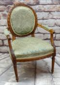 LOUIS XIV-STYLE CARVED BEECHWOOD FAUTEUIL, upholstered seat back and arms, fluted legs Condition: