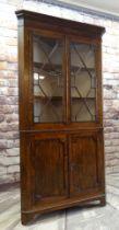 19TH CENTURY OAK STANDING CORNER CABINET, angled cornice with mahogany frieze, astragal glazed