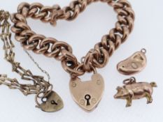 GOLD JEWELLERY comprising 9ct gold curb link bracelet with heart shaped padlock, two 9ct gold