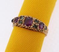 15CT GOLD EMERALD & GARNET RING, scroll engraved, ring size K, 2.1gms, in square cream ring box