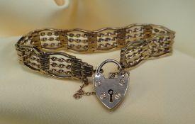 9CT GOLD GATE BRACELET, of barley twist design with heart shaped padlock, 20.5gms