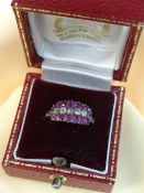 DIAMOND & RUBY TRIPLE ROW RING comprising five diamonds and sixteen rubies, ring size K, 1.8gms,