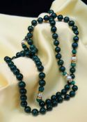 LONG STRING OF MALACHITE & PEARL BEADS, 90cms long, with jewellery pouch Condition: a few chips to