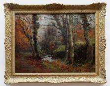 JOHN CUTHBERT SALMON RBA RCA oil on canvas - autumnal woodland with stream, signed, 45 x 60cms