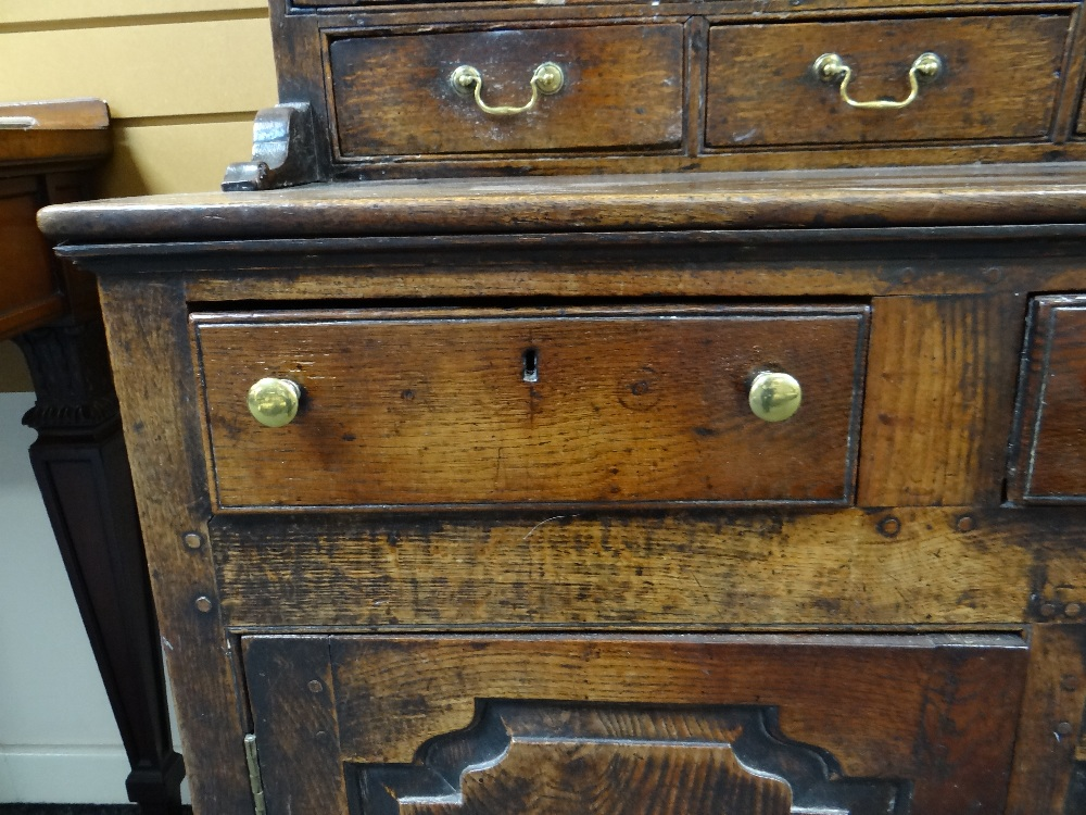 A SMALL CHARACTERFUL OAK NORTH WALES CUPBOARD-BASE WELSH DRESSER circa 1770-1800 having a base of - Image 16 of 26