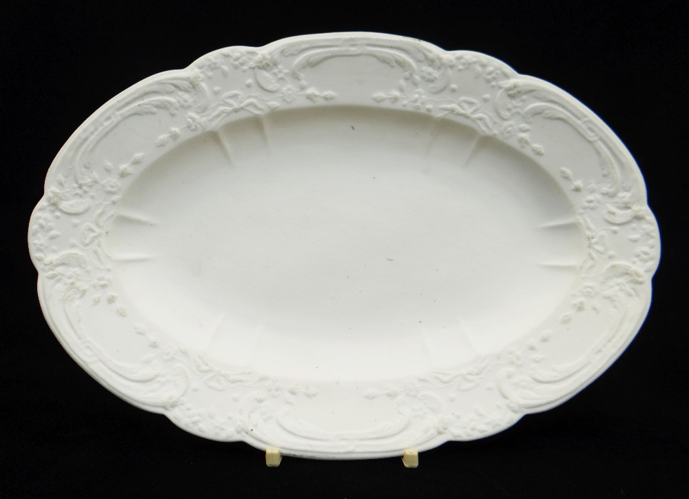 NANTGARW PORCELAIN UNGLAZED & NON DECORATED OVAL DISH typically moulded with c-scrolls, ribbons