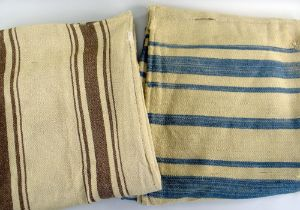 TWO HEAVY WEIGHT ANTIQUE WELSH BLANKETS with varying brown stripes and varying blue stripes, circa