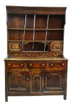 A SMALL CHARACTERFUL OAK NORTH WALES CUPBOARD-BASE WELSH DRESSER circa 1770-1800 having a base of