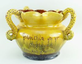 A EWENNY CLAYPITS POTTERY SLIPWARE JARDINIERE BY EVAN JONES of bellied form, with crimped rim and