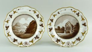 A PAIR OF SWANSEA CREAMWARE PLATES DECORATED BY THOMAS PARDOE with gilded silver-shaped rim, the
