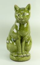 LARGE EWENNY POTTERY MODEL OF A SEATED CAT in green glaze, incised decoration, geometric design