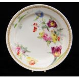 A SWANSEA GLASSY PORCELAIN PLATE DECORATED BY HENRY MORRIS of non-moulded circular form, floral