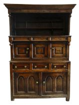 EARLY EIGHTEENTH CENTURY SNOWDONIA CWPWRDD TRIDARN the two cupboard base with arched fielded