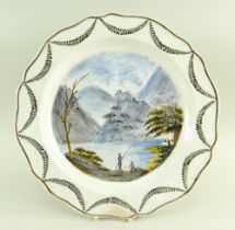 A SWANSEA POTTERY 1802-1810 PEARLWARE CHARGER DISH of lobed form, the interior painted with a