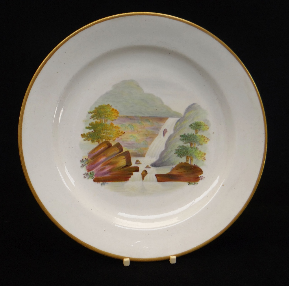 A SWANSEA PORCELAIN PLATE DECORATED BY WILLIAM WESTON YOUNG with centred Glynneath waterfall